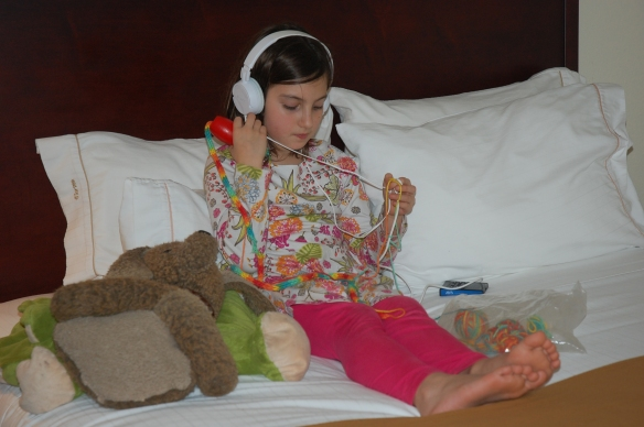 Henna jamming to a book while knitting away at our hotel in MO