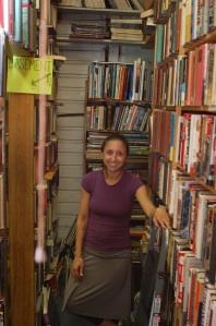 Jennifer Fredette surrounded by her books